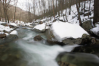 Frozen river flowing in wintertime in Nelson County in the moutains.