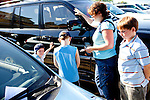 Isaac Williams, 5, Malachi Williams, 8, their mother Shannon Williams and Dalton Lariscey, 10, pray for the owners of a parked car in the National Hills Baptist Church's lot, which was free to everyone. The church, which is surrounded by lots costing $20, is just one block from Augusta National Golf Course in Augusta, Georgia April 6, 2010. he church members offered free coffee and parking, along with prayers that car owners requested and filled out on cards and left on their windshields in the lot.