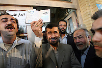 Iranian President Mahmoud Ahmadinejad shows his birth certificate to vote at South Tehran's Bagherzadegan Mosque during elections for the Guardian council.
