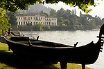 An antique gondola in the gardens of the Villa Melzi near Bellagio on Lake Como, Italy.