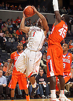 Feb. 2, 2011; Charlottesville, VA, USA; Virginia Cavaliers guard Jontel Evans (1) shoots next to Clemson Tigers forward/center Jerai Grant (45) during the game at the John Paul Jones Arena. Virginia won 49-47. Mandatory Credit: Andrew Shurtleff