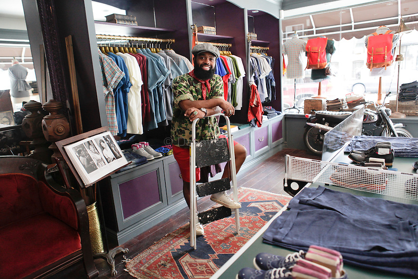Ouigi Theodore, 35, poses for a portrait at Brooklyn Circus in Brooklyn on Tuesday August 9, 2011. He is the owner and creative director of the history-inspired boutique. A second store is in San Francisco. ..Danny Ghitis for The New York Times