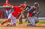 11 March 2013: Washington Nationals catcher Kurt Suzuki is unable to tag Jordan Schafer at home during a Spring Training game against the Atlanta Braves at Space Coast Stadium in Viera, Florida. The Braves defeated the Nationals 7-2 in Grapefruit League play. Mandatory Credit: Ed Wolfstein Photo *** RAW (NEF) Image File Available ***