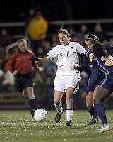 "Boston College forward Victoria DiMartino (1) passes under pressure. Boston College defeated West Virginia, 4-0, in NCAA tournament ""Sweet 16"" match at Newton Soccer Field, Newton, MA."