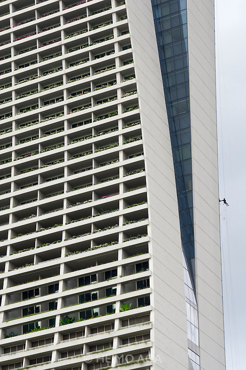 Singapore. Marina Bay Sands Hotel. Cleaning personnel working on windows and facade.