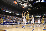 13 March 2015: Notre Dame's Bonzie Colson (35) shoots between Duke's Grayson Allen (3) and Marshall Plumlee (40). The Notre Dame Fighting Irish played the Duke University Blue Devils in an NCAA Division I Men's basketball game at the Greensboro Coliseum in Greensboro, North Carolina in the ACC Men's Basketball Tournament semifinal game. Notre Dame won the game 74-64.