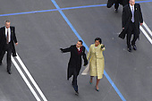 Washington, DC - January 20, 2009 -- United States President Barack Obama and first lady Michelle Obama wave to the crowd as they make their way down Pennsylvania Avenue during the 2009 presidential inaugural parade in Washington, D.C., Tuesday, January 20, 2009.  More than 5,000 men and women in uniform are providing military ceremonial support to the presidential inauguration, a tradition dating back to George Washington's 1789 inauguration.  Credit: Timothy Kingston - DoD via CNP