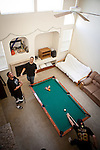 University of California, Merced students, from left, Gurbir Dhillon, Matthew Moy, and Mario Guerrero play pool in the spacious rental home they share in Merced, Calif., October 29, 2011.