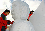 A model is displayed for reference as artists from Hong Kong carve ice sculptures .during the Sapporo Snow and Ice Festival in Sapporo City, northern Japan. Around 2 million people visit the city to see the hundreds of hand-crafted snow and ice sculptures that have graced the Sapporo Snow and Ice Festival since its inception in 1950.  The festival also features an international contest for ice sculptors from around the globe.