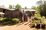 May 8, 2015. Chapel Hill, North Carolina.<br />  Matt Daley (left), an employee of the NC Botanical Gardens, stands in front of Patrick Dougherty's sculpture &quot;Homegrown&quot; while talking to (left to right) Sarah Dunn, Marlene Fessick and Charlotte Malone, visitors to the Gardens from Tennessee on a 10 day southeastern garden tour. <br />  Outsiders tend to lump Chapel Hill with nearby Durham, but the more sensible pairing is with Carrboro, the adjacent town that was once a mere offshoot known as West End. Even today the transition from Chapel Hill, anchored by North Carolina''s flagship public university, into downtown Carrboro is virtually seamless.
