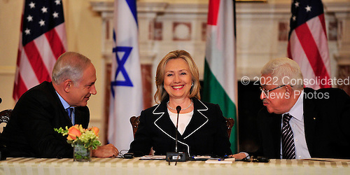 "United States Secretary of State Hillary Rodham Clinton, center, smiles as Prime Minister Benjamin Netanyahu of Israel, left, and Mahmoud Abbas of the Palestinian Authority share some thoughts following their remarks at the start of the ""Relaunch of Direct Negotiations Between the Israelis and Palestinians"" in the Benjamin Franklin Room of the U.S. Department of State on Thursday, September 2, 2010.  .Credit: Ron Sachs / CNP.(RESTRICTION: NO New York or New Jersey Newspapers or newspapers within a 75 mile radius of New York City)"