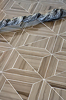 Truman, a natural stone waterjet mosaic shown in Driftwood polished, is part of the Parquet Line by Sara Baldwin for New Ravenna Mosaics.