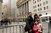 Tourist stand in front the New York Stock Exchange while At&t Management discusses Q4 2011 results in New York, United States. 26/01/2012. Photo by Kena Betancur / VIEWpress.