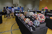 OrigamiUSA 2014 exhibition. Modular origami designed and folded by Byriah Loper in the foreground