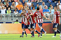 Chivas USA players celebrate their opening goal scored by Nick LaBrocca... Sporting KC and Chivas USA played to a 1-1 tie at LIVESTRONG Sporting Park, Kansas City, Kansas.