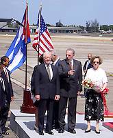 "Former U.S. President Jimmy Carter (L) talks with Cuban President Fidel Castro during a welcoming ceremony at ""Jose Marti"" International airport in Havana, May 12, 2002. Carter is on a six-day visit to Cuba, and is the first American president to visit the communist island since Fidel Castro took power in 1959.. Credit: Jorge Rey/MediaPunch"