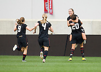 Lauren Cheney (12) of the USWNT celebrates her goal with Abby Wambach (20) and other teammates during the game at Red Bull Arena in Harrison, NJ.  The USWNT defeated Mexico, 1-0.