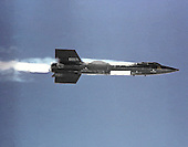 X-15  #2 in flight, just after launch from a B-52 in the early 1960s. This joint program by the National Aeronautics and Space Administration (NASA), the United States Air Force, the United States Navy, and North American Aviation, Inc. operated the most remarkable of all the rocket research aircraft. Composed of an internal structure of titanium and a skin surface of a chrome-nickel alloy known as Inconel X, the X-15 had its first, unpowered glide flight on June 8, 1959, while the first powered flight took place on September 17, 1959. Because of the large fuel consumption of its rocket engine, the X-15 was air launched from a B-52 aircraft at about 45,000 ft and speeds upward of 500 mph. The airplane first set speed records in the Mach 4-6 range with Mach 4.43 on March 7, 1961; Mach 5.27 on June 23, 1961; Mach 6.04 on November 9, 1961; and Mach 6.7 on October 3, 1967. It also set an altitude record of 354,200 feet (67 miles) on August 22, 1963, and provided an enormous wealth of data on hypersonic air flow, aerodynamic heating, control and stability at hypersonic speeds, reaction controls for flight above the atmosphere, piloting techniques for reentry, human factors, and flight instrumentation. The highly successful program contributed to the development of the Mercury, Gemini, and Apollo piloted spaceflight programs as well as the Space Shuttle program. The program's final flight was performed on October 24, 1968.