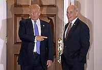 United States President-elect Donald Trump (L) gestures with retired US Marine Corp General John Kelly at the clubhouse of Trump International Golf Club, in Bedminster Township, New Jersey, USA, 20 November 2016.<br /> Credit: Peter Foley / Pool via CNP /MediaPunch