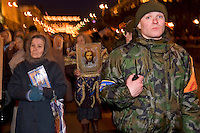 Kiev, Ukraine, 25/12/2004..The third and final round of Ukraine's disputed Presidential election. Supporters of candidate Viktor Yushchenko in military uniform escort an Orthodox Church procession on Christmas Day.