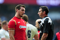 Sam Warburton of Wales speaks to referee Craig Joubert during a break in play. RBS Six Nations match between England and Wales on March 12, 2016 at Twickenham Stadium in London, England. Photo by: Patrick Khachfe / Onside Images