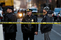 Police officers talk at a cordoned crime scene at the entrance of the building related to the shootings at Sandy Hook Elementary School, in Hoboken, United States. 14/12/2012. Photo by ZAMEK