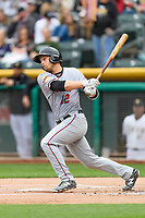 Austin Slater (12) of the Sacramento River Cats follows through on his swing against the Salt Lake Bees during the Pacific Coast League game at Smith's Ballpark on August 11, 2017 in Salt Lake City, Utah. The River Cats defeated the Bees 8-7. (Stephen Smith/Four Seam Images)