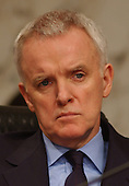Washington, D.C. - April 13, 2004 --  National Commission on Terrorist Attacks Upon the United States (the 9-11 Commission) Commissioner Bob Kerrey listens to the testimony of Janet Reno in Washington, DC on April 13, 2004.<br /> Credit: Ron Sachs / CNP<br /> [RESTRICTION: No New York Metro or other Newspapers within a 75 mile radius of New York City]