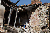 Inside the Red Zone delimiting the medieval center of L'Aquila. The interiors of the houses, fled on a deadly night of six years ago, still show the signs of an abruptly interrupted life.  L'Aquila, Italy. Apr. 10, 2015