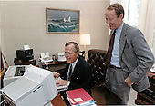 United States President George H.W. Bush shows his computer skills to U.S. Secretary of Education Lamar Alexander in the private study off the Oval Office of the White House in Washington, D.C. on April 24, 1991.<br /> Mandatory Credit: Susan Biddle / White House via CNP