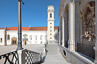 University clock tower, designed by Italian architect Antonio Canevari and built 1728-33, and on the right, allegorical sculptures along the facade of the Via Latina, in the portico of 1700-02 designed by Claude Laprade, 1682-1738, at the University of Coimbra in the former Palace of the Alcazaba, Coimbra, Portugal. The University of Coimbra was first founded in 1290 and moved to Coimbra in 1308 and to the royal palace in 1537. The buildings are listed as a historic monument and a UNESCO World Heritage Site. Picture by Manuel Cohen