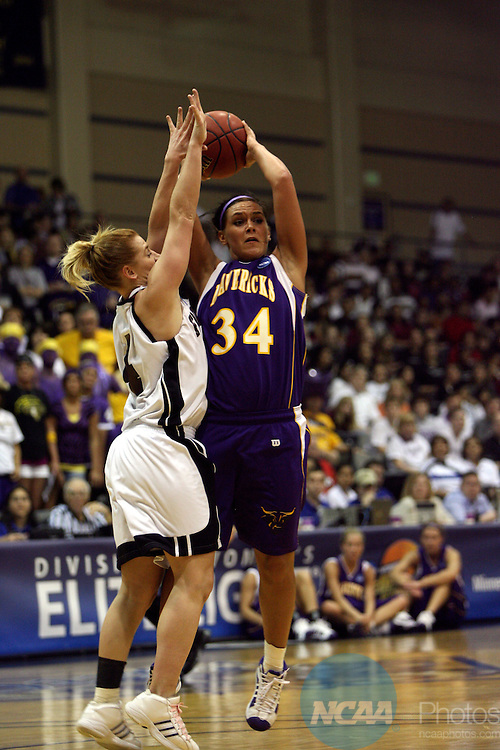 27 MAR 2009:  Guard Flecia Foster (34) of Minnesota State University- Mankato tries to pass around guard Jennifer Leedham (4) of Franklin Pierce during the Division II Women's Basketball Championship held at the Bill Greehey Arena on the St. Mary's University campus in San Antonio, Tx.  MSU-Mankato defeated Franklin Pierce 103-94 to win the national title game.  Rodolfo Gonzalez/NCAA Photos