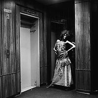 A mannequin modelling clothes stands outside a lift in the Pressmall Building on President Street in central Johannesburg.