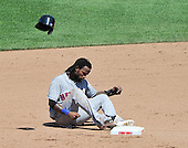 New York Mets shortstop Jose Reyes (7) throws his batting helmet in disgust after being tagged out by Washington Nationals shortstop Ian Desmond (6) trying to steal in the fifth inning at Nationals Park in Washington, D.C. on Sunday, July 31, 2011.  .Credit: Ron Sachs / CNP.(RESTRICTION: NO New York or New Jersey Newspapers or newspapers within a 75 mile radius of New York City)