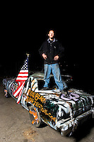 Donovan shows off his car. Demolition Derby at the Orange Show Raceway, San Bernardino, Southern California, California, United States, North America. October 2008, ©Stephen Blake Farrington