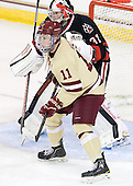 Pat Mullane (BC - 11), Chris Rawlings (NU - 37) - The Boston College Eagles defeated the visiting Northeastern University Huskies 3-0 after a banner-raising ceremony for BC's 2012 national championship on Saturday, October 20, 2012, at Kelley Rink in Conte Forum in Chestnut Hill, Massachusetts.
