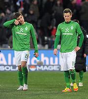 FUSSBALL   1. BUNDESLIGA   SAISON 2011/2012    20. SPIELTAG  05.02.2012 SC Freiburg - SV Werder Bremen Sokratis Papastathopoulos (li, SV Werder Bremen) und Markus Rosenberg (SV Werder Bremen) nachdenklich