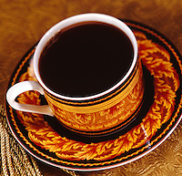 Black Coffee in golden and black cup