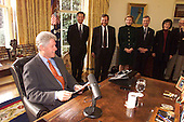 United States President Bill Clinton prepares to deliver his weekly radio address from the Oval Office of the White House in Washington, D.C. on January 15, 2000.  Joining the President are: (Left to right) Acting Assistant Attorney General for Civil Rights Bill Lan Lee; Jay Kaiman of the Anti-Defamation League; Christine Miliken, Executive Director of the National Association of Attorneys General; Former U.S. Representative Bob Edgar (Democrat of Pennsylvania), General Secretary of the National Council of the Churches of Christ; Umi Song, Chair of the National Asian Pacific American Legal Consortium..Credit: White House via CNP