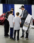 Patch Alber (BC - 27) and Parker Milner (BC - 35) stop to sign autographs. - The Boston College Eagles defeated the Merrimack College Warriors 5-3 to win the Hockey East championship for the tenth time on Saturday, March 19, 2011, at TD Garden in Boston, Massachusetts.
