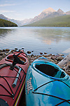 Two kayaks rest along the shores of Bowman Lake, Glacier National Park, Montana