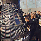 """United States President John F. Kennedy inspects interior of """"Friendship 7"""" on February 23, 1962 at Hanger S, Cape Canaveral, Florida.   The President presented the NASA Distinguished Service Medal (DSM) to Astronaut Glenn.  Left to right: President Kennedy, Lieutenant Colonel John H. Glenn, Jr., others. .Mandatory Credit: Cecil Stoughton - The White House via CNP"""