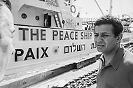 02 Oct 1969 --- Radio broadcaster Abie Nathan with his M.V. Peace ship moored in harbor. Nathan plans to moor his boat in international waters and broadcast peace messages to Israel. --- Image by © JP Laffont