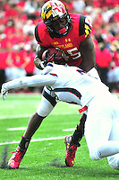 RB Brandon Ross of the Terrapins tries to avoid a tackle. Maryland defeated Richmond 50-21 during home season opener at the Byrd Stadium in College Park, MD on Saturday, September 5, 2015.  Alan P. Santos/DC Sports Box