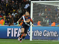 Defender Oguchi Onyewu tracks the flight of the ball towards goal. The United States came from a 2-0 halftime deficit to Slovenia to earn a 2-2 draw their second match of play in Group C of the 2010 FIFA World Cup..