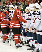 Ryan Ellis (Canada - 6), Patrice Cormier (Canada - 28) - Team USA celebrates after defeating Team Canada 6-5 (OT) to win the gold medal in the 2010 World Juniors tournament on Tuesday, January 5, 2010, at the Credit Union Centre in Saskatoon, Saskatchewan.