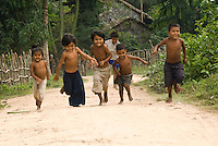 Kids in a small village around 30 km from Siem Reap run towards visitors as they stroll through their village. Life in the small villages is very different to life in the city of Siem Reap despite it's proximity. The average family in Cambodia lives on less than a dollar US per day -- and even lower in rural areas such as this one.