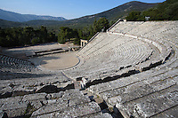 EPIDAURUS, GREECE - APRIL 14 : A view from above of the Theatre, on April 14, 2007 in Epidaurus, Greece. The Theatre, designed by Polykleitos the Younger, was built in the late 4th century BC and extended in the Hellenistic period. It was rediscovered in 1881 and significantly restored in the 1950s.  It has the three main features of a Greek theatre: the orchestra, a sunken round stage; the skene, a raised rectangular stage; and the cavea, a raked semi-circular auditorium with radiating diazomas. The theatre is renowned for its accoustics thanks to the symmetry of the cavea, and for its beautiful mountain view, seen here in the late afternoon light. (Photo by Manuel Cohen)