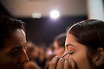 A model gets her make-up done, backstage for the Brazilian brand, Neon, at São Paulo Fashion Week for Summer Season 2013/2014, at Bienal, in São Paulo, Brazil, on Wednesday, March 20, 2013.