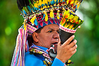 """A shaman from the Kamentsá tribe, wearing a colorful feather headgear, plays horn trumpet during the Carnival of Forgiveness, a traditional indigenous celebration in Sibundoy, Colombia, 12 February 2013. Clestrinye (""""Carnaval del Perdón"""") is a ritual ceremony kept for centuries in the Valley of Sibundoy in Putumayo (the Amazonian department of Colombia), a home to two closely allied indigenous groups, the Inga and Kamentsá. Although the festival has indigenous origins, the Catholic religion elements have been introduced and merged with the shamanistic tradition. Celebrating annually the collaboration, peace and unity between tribes, they believe that anyone who offended anyone may ask for forgiveness this day and all of them should grant pardons."""